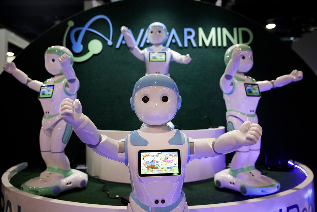 . AvatarMind\'s iPal companion robots are displayed at CES International, Wednesday, Jan. 10, 2018, in Las Vegas. (AP Photo/Jae C. Hong)