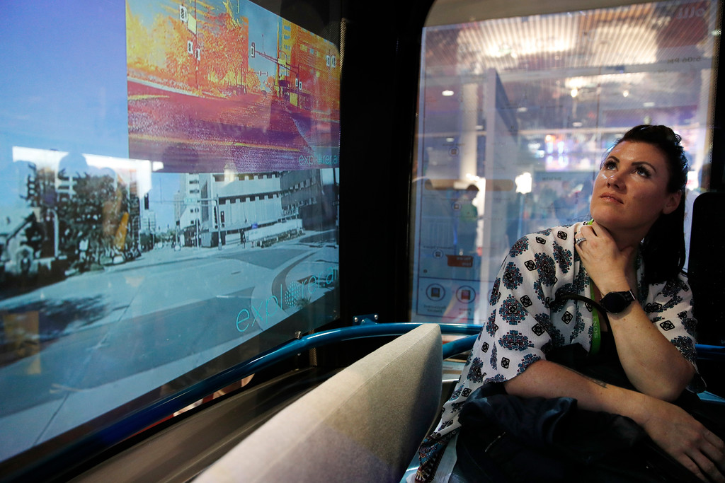 . Katie Ferencik sits on the Olli autonomous concept bus during CES International, Tuesday, Jan. 9, 2018, in Las Vegas. (AP Photo/John Locher)