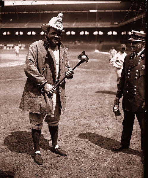Never one to pass up a photo opportunity, Babe Ruth dons fire gear for  photographers at Comiskey Park in 1928.<br /> ..OUTSIDE TRIBUNE CO.- NO MAGS,  NO SALES, NO INTERNET, NO TV, CHICAGO OUT.. 00297775A The Babe in Chicago