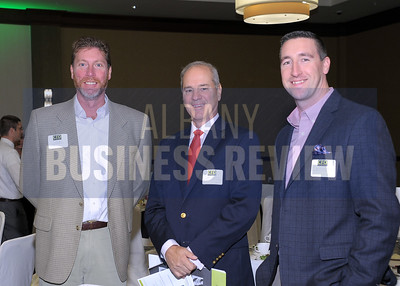 Timothy Plant of Structural Services, left, with Auto/Mate's president and CEO Mike Esposito and Dave Druzynski.