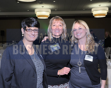 Honoree Carole Plant, CFO at Auto/Mate, with left, Pamela Canty and Brittany Hainer of FirstLight Fiber.