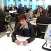 Susanna Cherubin-Delisi (Italian Consulate Liaison) shares information during speed networking session in Chicago.
