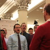 """Chicago Gay Men's Chorus at Macy's """"Believe Day"""" on Friday, December 10, 2010.  <br /> <br /> Caption:  Patrick Sinozich, Artistic Director of Chicago Gay Men's Chorus, conducts members of the chorus at Macy's Believe Day on December 10, 2010.  <br /> <br /> Photo Credit: Rick Aiello/Steven Sisk"""