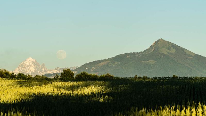 Full moon rising between Aguille Vert & Le Môle.
