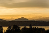 Panoramic view of Aguille Vert & Mont Blanc in early-morning golden light with Lake Geneva in foreground