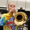 Chelmsford All Town Wind Ensemble was preparing to perform at the National Band and Orchestra Festival at Carnegie Hall in New York City in March at McCarthy Middle School on Wednesday night. Playing the trumpet during hte practice is sixth grader McKenna Hughes. SUN/JOHN LOVE