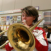 Chelmsford All Town Wind Ensemble was preparing to perform at the National Band and Orchestra Festival at Carnegie Hall in New York City in March at McCarthy Middle School on Wednesday night. Playing the trombone during the practice is sixth grader Allyson Adams. SUN/JOHN LOVE