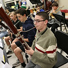 Chelmsford All Town Wind Ensemble was preparing to perform at the National Band and Orchestra Festival at Carnegie Hall in New York City in March at McCarthy Middle School on Wednesday night. Playing the bassoon during the practice is high School student and original member of the ensemble John Lambert, 16. SUN/JOHN LOVE