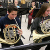 Chelmsford All Town Wind Ensemble was preparing to perform at the National Band and Orchestra Festival at Carnegie Hall in New York City in March at McCarthy Middle School on Wednesday night. Playiing the French horn during the practice is eighth graders Daniel Pinto, and Cchloe Molinari. SUN/JOHN LOVE