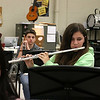 Chelmsford All Town Wind Ensemble was preparing to perform at the National Band and Orchestra Festival at Carnegie Hall in New York City in March at McCarthy Middle School on Wednesday night. Playing the flute during the practice is ninth grader Marissa Burati. SUN/JOHN LOVE