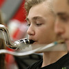 Chelmsford All Town Wind Ensemble was preparing to perform at the National Band and Orchestra Festival at Carnegie Hall in New York City in March at McCarthy Middle School on Wednesday night. Playing the bass clarinet during the practice is seventh grader Kenneth Damon. SUN/JOHN LOVE