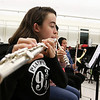 Chelmsford All Town Wind Ensemble was preparing to perform at the National Band and Orchestra Festival at Carnegie Hall in New York City in March at McCarthy Middle School on Wednesday night. Playing the flute during the practice is eighth grader Jennifer Purpura. SUN/JOHN LOVE