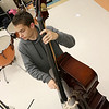 Chelmsford All Town Wind Ensemble was preparing to perform at the National Band and Orchestra Festival at Carnegie Hall in New York City in March at McCarthy Middle School on Wednesday night. playing the bass during the practice is freshman Ethan Meltzer, 13.  SUN/JOHN LOVE