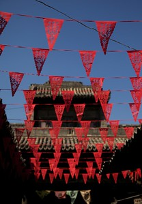 One moment dark and brooding, the next exploding with colour, Pingyao is a place of beauty and contrast.  China.  2012.