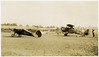 """1.  The airplane on the left has """"Monocoupe"""" on its side.  According to Wikipedia, the Monocoupe Corporation was founded in July 1934.  The airplane on the right is labeled U.S. ARMY / CURTISS 0 1B / A.C 27-273.  This is a variety of the Curtiss Falcon, """"a family of military biplane aircraft built by the Curtiss Aeroplane and Motor Company during the 1920s. Most saw service as part of the United States Army Air Corps as observation aircraft ... or as the attack aircraft designated the A-3 Falcon."""" (Wikipedia)."""