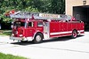 CRESTWOOD  TRUCK 2304  1979 SEAGRAVE  1250-200-100'  ALL RED WITH WHITE STRIPE