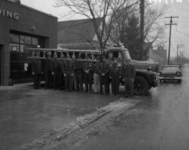 Tinley Park IL Fire Department. The Volunteer firemen are lined up in front of their newest ladder truck. December 11, 1958.