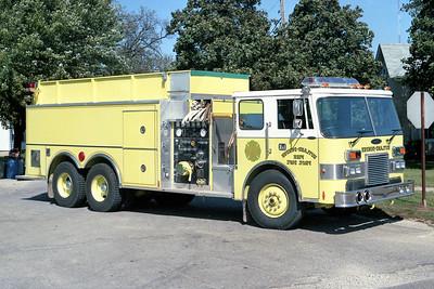 RUTLAND DUNDEE   TANKER 57   1989 PIERCE DASH   1250-3000   E-5048  TANDEM AXLE  OFFICERS SIDE