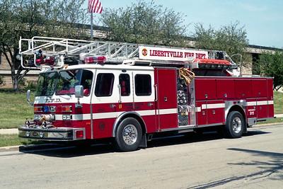 LIBERTYVILLE FD  1992  E-ONE HUSH   1250-500-75'   #10911