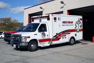 NORTH CHICAGO AMBULANCE FORD E  WHITE WITH RED STRIPE