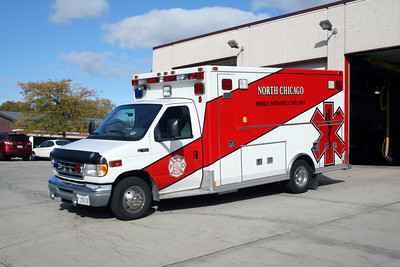 NORTH CHICAGO AMBULANCE FORD E WITH LARGE STRIPING