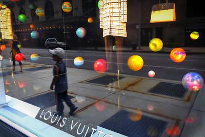 Boy reflected in window display