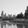LINCOLN PARK ZOO BRIDGE WITH CHICAGO SKYLINE B&W