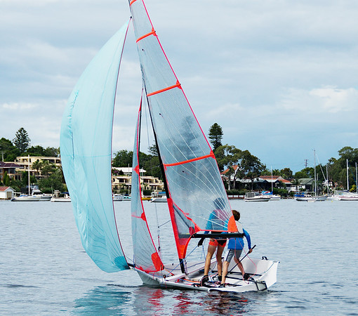 Two young boys sailing a 29er class dinghy with a clear mylar ma