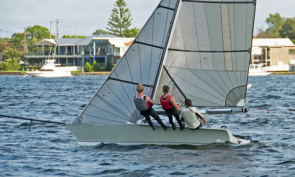 High school teens Sailing small sailboat with a Strong Wind on a