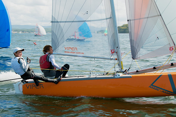 Children sailing racing dinghies at championships. April 17, 2