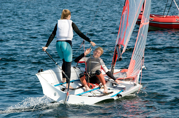Children sailing racing dinghies at championships. April 18, 2