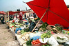Kashgar- Sunday Mal Bazaar animal market - selling vegetables