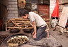 Kashgar- Sunday Mal Bazaar animal market - Baking charateristic islamic bread