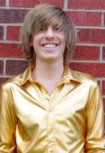 CHRIS BRAMBLE GOLD DRESS SHIRT ON BRICK WALL