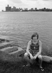 CHRIS CLARK SITTING IN FRONT OF DETROIT ON BELL ISLE B&W