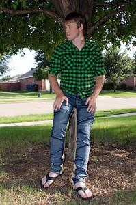 CHRIS LEANING ON TREE FULL