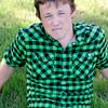 CHRIS GREEN SHIRT SITTING IN GRASS