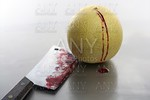 Bloody yellow melon killed by knife