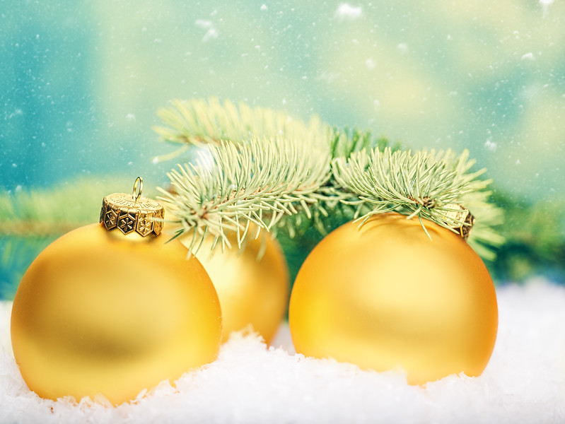 Golden balls. Abstract Xmas decorations over white snow