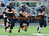"The ""Big Boys"" trot back to the line, during the CHS varsity game vs Fenton.<br /> <br /> (New image added 9-23-11)"