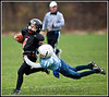 Charlotte vs Maple Valley Junior Football at Charlotte MI.<br /> <br /> I try and catch the moment when a player (football, baseball even soccer) when one or both players are in mid air... this fits the bill.