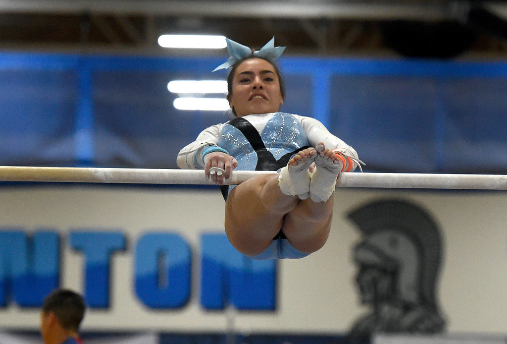 . THORNTON, CO - NOVEMBER 1, 2018: Mountain Range High School\'s Jules Medina competes in the uneven bars during the CHSAA 5A gymnastics championships on Thursday at Thornton High School. More photos: BoCoPreps.com (Jeremy Papasso/Staff Photographer)