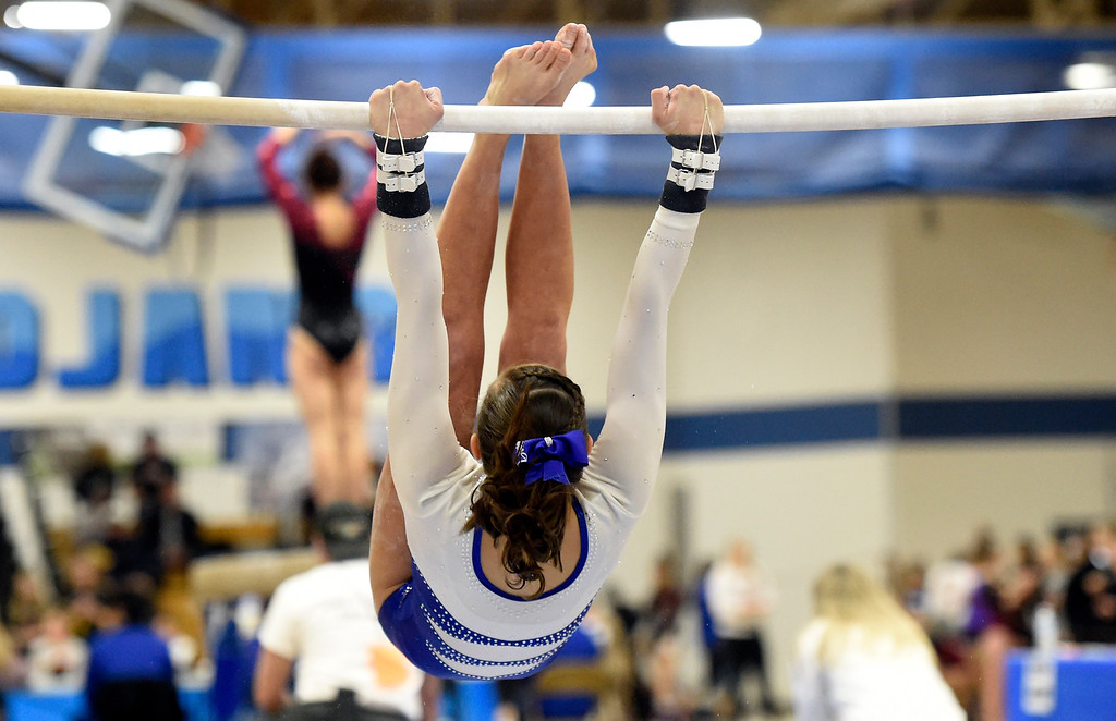 . THORNTON, CO - NOVEMBER 1, 2018: Broomfield High School\'s Darcy Jew competes on the uneven bars during the CHSAA 5A gymnastics championships on Thursday at Thornton High School. More photos: BoCoPreps.com (Jeremy Papasso/Staff Photographer)