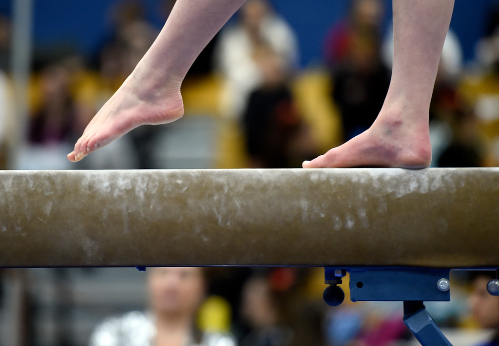 . THORNTON, CO - NOVEMBER 1, 2018: A gymnast competes in the balance beam during the CHSAA 5A gymnastics championships on Thursday at Thornton High School. More photos: BoCoPreps.com (Jeremy Papasso/Staff Photographer)