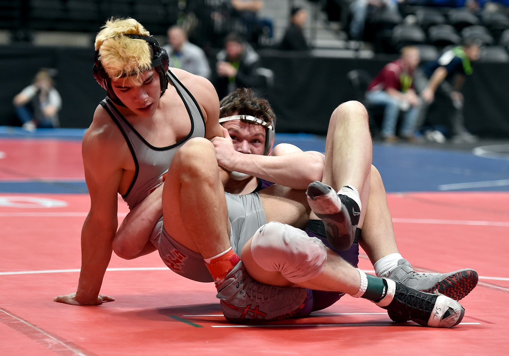 . DENVER, CO - FEBRUARY 21, 2019: Holy Family High School\'s Hunter Branson wrestles Jefferson\'s Randy Duran during a 3A 170-pound match during the first day of the CHSAA State Wrestling Championships on Thursday at the Pepsi Center in Denver. Branson won the match. More photos: BoCoPreps.com (Photo by Jeremy Papasso/Staff Photographer)