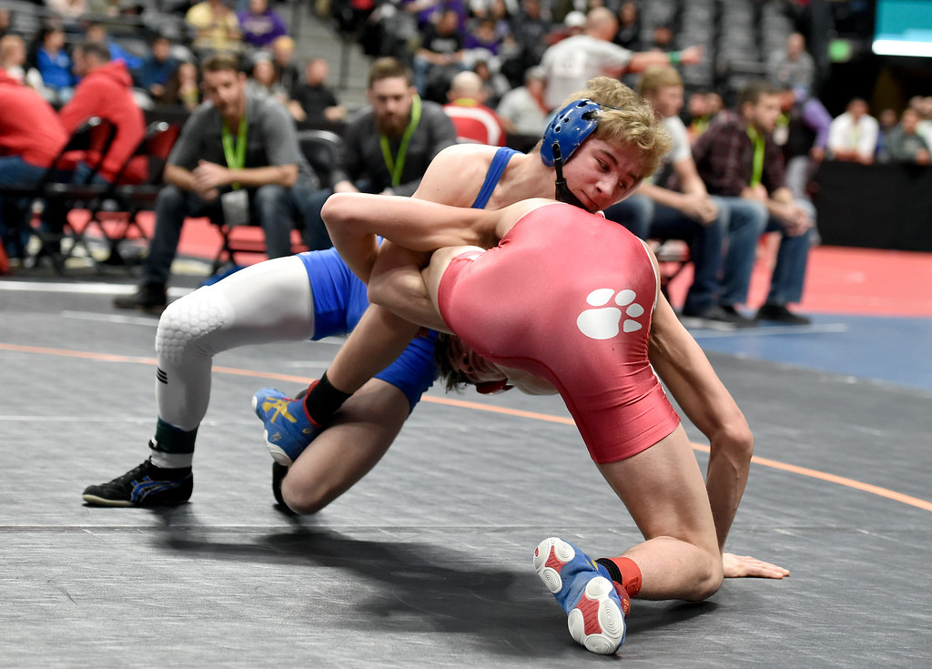 . DENVER, CO - FEBRUARY 21, 2019: Lyons High School\'s Oran Huff wrestles Ignacio\'s Hunter Robbins during a 2A 126-pound match during the first day of the CHSAA State Wrestling Championships on Thursday at the Pepsi Center in Denver. Huff pinned Robbins in 17 seconds of the first period. More photos: BoCoPreps.com (Photo by Jeremy Papasso/Staff Photographer)