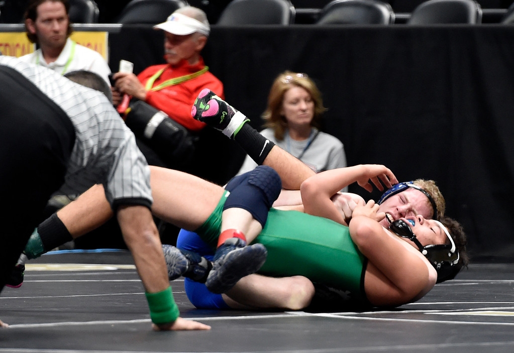 . DENVER, CO - FEBRUARY 21, 2019: Lyons High School\'s Logan Odell works to pin Sanford\'s Brady Kuhns during a 2A 152-pound match against during the first day of the CHSAA State Wrestling Championships on Thursday at the Pepsi Center in Denver. Odell won the match. More photos: BoCoPreps.com (Photo by Jeremy Papasso/Staff Photographer)