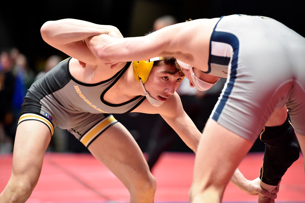 . DENVER, CO - FEBRUARY 21, 2019: Monarch High School\'s Ryan Kuykendall ties up with Legacy\'s Keegan Hoffman during a  5A 113-pound match during the first day of the CHSAA State Wrestling Championships on Thursday at the Pepsi Center in Denver. More photos: BoCoPreps.com (Photo by Jeremy Papasso/Staff Photographer)