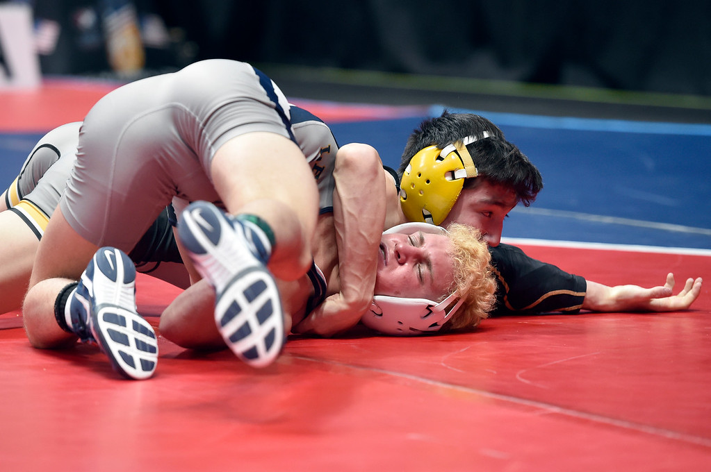 . DENVER, CO - FEBRUARY 21, 2019: Monarch High School\'s Ryan Kuykendall works to pin Keegan Hoffman, of Legacy, during a 5A 113 -pound match during the first day of the CHSAA State Wrestling Championships on Thursday at the Pepsi Center in Denver. More photos: BoCoPreps.com (Photo by Jeremy Papasso/Staff Photographer)