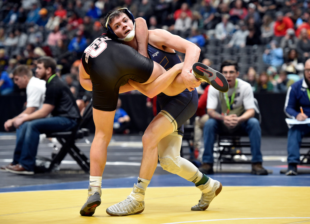 . DENVER, CO - FEBRUARY 21, 2019: Frederick High School\'s Cole Hoffman takes down Grand Junction Central\'s Jason Pollard during a  4A 132-pound match during the first day of the CHSAA State Wrestling Championships on Thursday at the Pepsi Center in Denver. Hoffman lost the match. More photos: BoCoPreps.com (Photo by Jeremy Papasso/Staff Photographer)